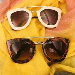 2 pairs of Sunglasses